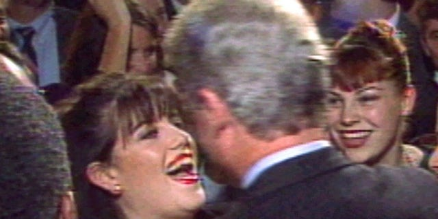 President Clinton greets Monica Lewinsky (L) at a Washington fundraising event in October 1996.