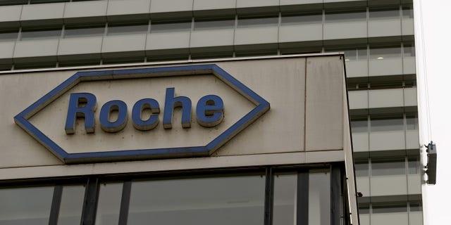 Swiss drugmaker Roche's logo is seen at their headquarters in Basel, Switzerland October 22, 2015. REUTERS/Arnd Wiegmann