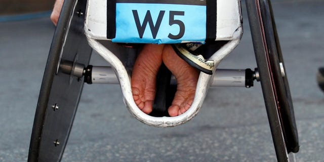 The feet of an athlete are tucked into his wheelchair at the 116th Boston Marathon in Boston, Massachusetts April 16, 2012. REUTERS/Brian Snyder