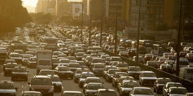 Cars sit in a traffic jam in Lima