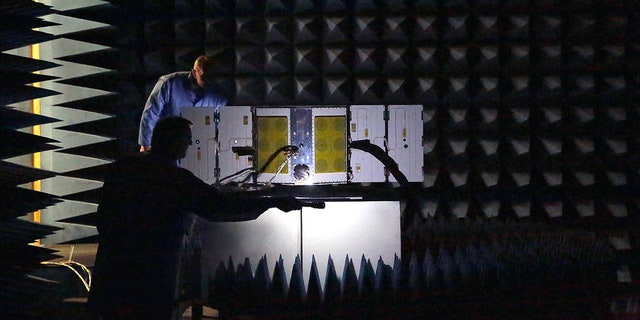 As part of a series of environmental tests for NASA's CYGNSS constellation, one of the eight microsatellites is placed in a radio frequency (RF) anechoic chamber.
