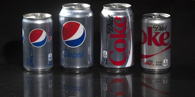 Regular and mini cans of Diet Coke and Diet Pepsi are pictured in this photo illustration in New York