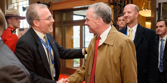 David Kramer greets Sen. Tim Kaine at the Halifax International Security Forum in November 2016.