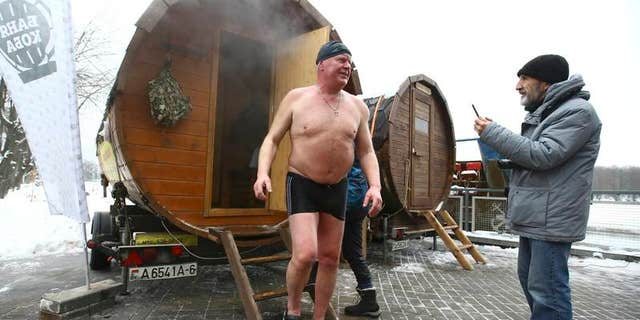 Man leaves sauna during Belarusian winter swimming championship in Minsk
