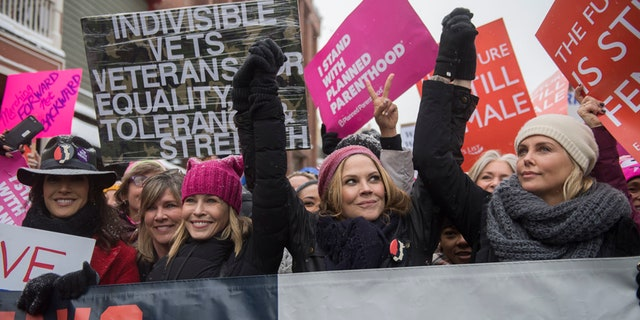 """Actresses Chelsea Handler and Charlize Theron, right, participate in the """"Women's March On Main"""" during the 2017 Sundance Film Festival on Saturday, Jan. 21, 2017, in Park City, Utah. (Photo by Arthur Mola/Invision/AP)"""