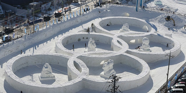 Visitors tour near the snow sculpture in the shape of the Olympic rings at a snow festival in Pyeongchang, South Korea. Pyeongchang is the host city for the 2018 Olympic and Paralympic Winter Games.