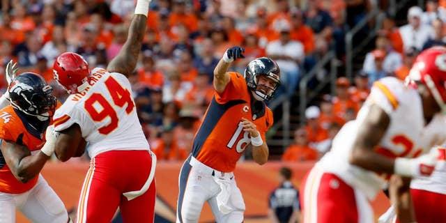 Denver Broncos quarterback Peyton Manning (18) throws against the Kansas City Chiefs during the second half of an NFL football game, Sunday, Sept. 14, 2014, in Denver. (AP Photo/Joe Mahoney)