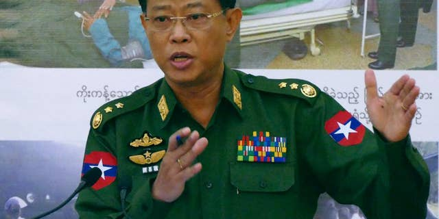 Myanmar's Chief of Military Affairs Security, Lt. Gen. Mya Tun Oo, talks to journalists during a press conference at the Defense Ministry Saturday, Feb. 21, 2015, in Naypyitaw, Myanmar. Myanmar is claiming that allied minority rebel groups and former Chinese soldiers recruited as mercenaries are supporting ethnic Kokang rebels in fighting against government troops. (AP Photo/Khin Maung Win)