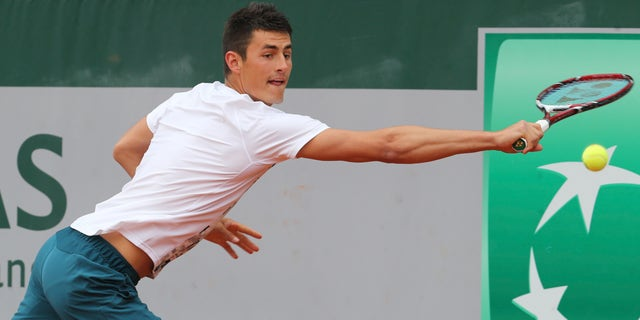 Australia's Bernard Tomic returns against Romania's Victor Hanescu during their first round match at the French Open tennis tournament, at Roland Garros stadium in Paris, Tuesday, May 28, 2013. (AP Photo/Michel Euler)