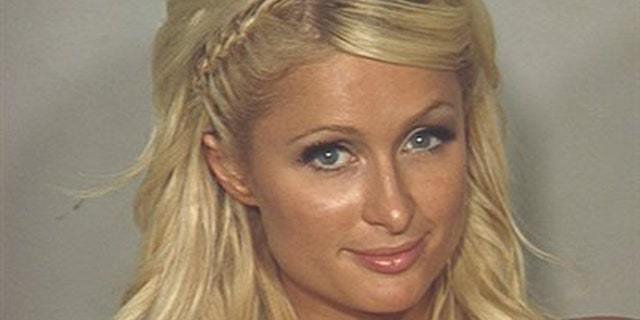 In this photo released Saturday, Aug. 28, 2010 by the Las Vegas Metropolitan Police Department, Paris Hilton is seen in her police booking photo in Las Vegas.