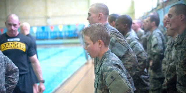 """""""Male and female Ranger Training Assessment Course students demonstrate their knowledge of combat water survival techniques at the Briant Wells Gym indoor pool Jan. 24, 2015 during the Ranger Training Course Assessment at Fort Benning, Georgia. The combat water survival training included a 15-meter swim and a 3-meter blind drop into the water with combat equipment. (U.S. Army photo by Patrick A. Albright/Released)    """""""