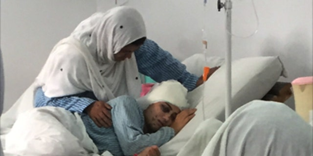 A young woman fights for survival after being shot in an attempted car theft in Kabul, Afghanistan
