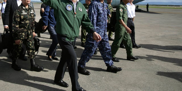 Japanese Defense Minister Itsunori Onodera is seen in the Philippines, Dec. 8, 2013, during his previous stint in the job.