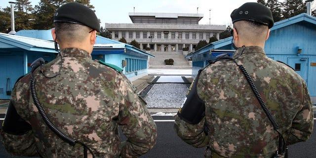 South Korean soldiers stand guard at the truce village of Panmunjom in the demilitarized zone separating the two Koreas.