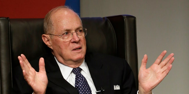 Supreme Court Justice Anthony Kennedy speaks to faculty members at the University of Pennsylvania law school, Thursday, Oct. 3, 2013, in Philadelphia. Kennedy is teaching this week at the University of Pennsylvania law school.(AP Photo/Matt Slocum)