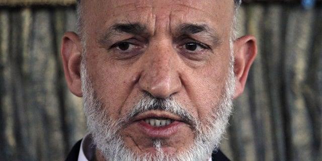 Oct. 9: Afghan President Hamid Karzai speaks in Kandahar province.