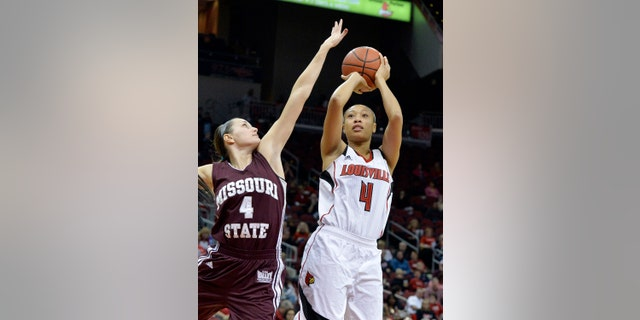 Louisville's Antonita Slaughter, right, gets a shot off over the defense of Missouri State's Kenzie Williams during the first half of an NCAA college basketball game Tuesday, Dec. 3, 2013, in Louisville, Ky. (AP Photo/Timothy D. Easley)