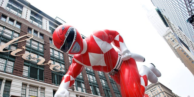 The Red Power Ranger soars above the holiday crowds.