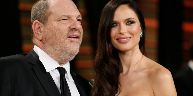 FILE -- Producer Harvey Weinstein and his wife, actress Georgina Chapman arrive at the 2014 Vanity Fair Oscars Party in West Hollywood, California March 2, 2014.