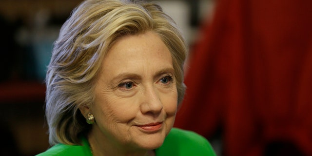 Democratic presidential candidate Hillary Rodham Clinton meets with local residents at the Jones St. Java House, Tuesday, April 14, 2015, in LeClaire, Iowa. (AP Photo/Charlie Neibergall)