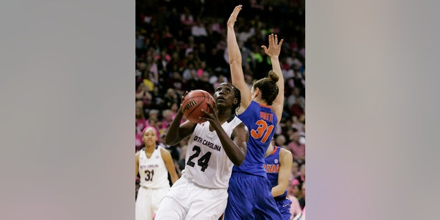 South Carolina's Aleighsa Welch (24) gets past Florida's Lily Svete as she drives for the basket during the second half of their NCAA college basketball game, Sunday, Feb. 23, 2014, in Columbia, SC. (AP Photo/Mary Ann Chastain)