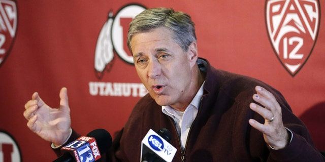 Utah athletic director Chris Hill announces the suspension of swim coach Greg Winslow during a college news conference, Thursday, Feb. 28, 2013, in Salt Lake City. The suspension comes amidst allegations that Winslow sexually abused an teenage female swimmer he coached in Arizona six years ago. (AP Photo/Rick Bowmer)