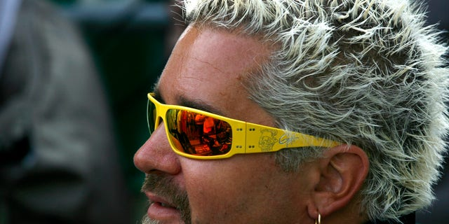 Designated Pace car driver and celebrity chef Guy Fieri is pictured during Fan Appreciation Day at the Indianapolis Motor Speedway in Indianapolis, Indiana May 26, 2012.  the Indianapolis 500 is scheduled to run on May 27. REUTERS/Matt Sullivan (UNITED STATES - Tags: SPORT MOTORSPORT FOOD) - RTR32NXR