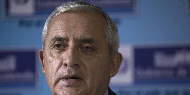 FILE - In this June 11, 2015 file photo, Guatemala's President Otto Perez Molina gives a press conference at the Interior Ministry in Guatemala City. Guatemala's constitutional court has temporarily blocked an effort to strip Perez Molina of immunity as corruption investigations advance. (AP Photo/Luis Soto, File)