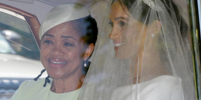 Meghan Markle, right, and her mother Doria Ragland leave Cliveden House Hotel in Taplow, near London, England, May 19, 2018, before Markle's wedding ceremony with Prince Harry at St. George's Chapel in Windsor Castle. (AP Photo/Tim Ireland)