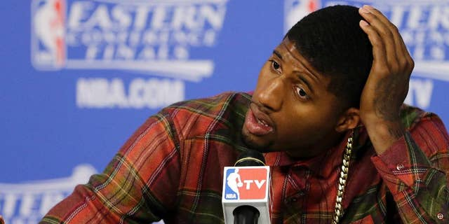 Indiana Pacers forward Paul George speaks during the post-game news conference after Game 4 in the NBA basketball Eastern Conference finals playoff series, Tuesday, May 27, 2014, in Miami. The Heat won 102-90. (AP Photo/Wilfredo Lee)