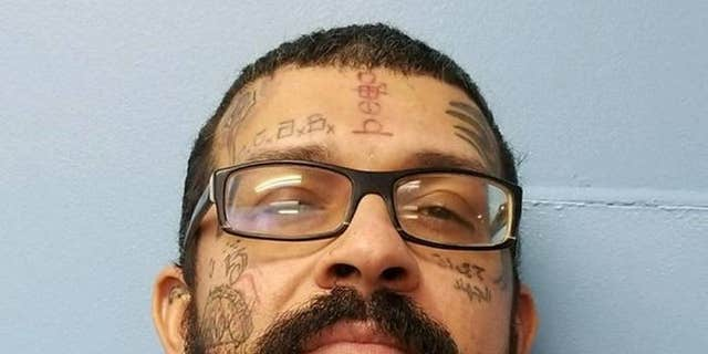 Robert Paul Alexander Edwards, 33, was determined to have drawn the picture and was charged with written threat to kill or do bodily injury.