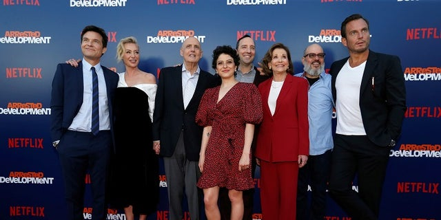 "[Left to right] Jason Bateman, Portia de Rossi, Jeffrey Tambor, Alia Shawkat, Tony Hale, Jessica Walter, David Cross and Will Arnett of ""Arrested Development."""