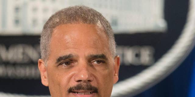 FILE - This July 14, 2014 file photo shows Attorney General Eric Holder speaking at the Justice Department in Washington. Holder said Thursday he's concerned about police use of military equipment in Ferguson, Mo. (AP Photo/Pablo Martinez Monsivais, File)