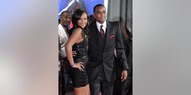 """FILE - In this Aug. 16, 2012, file photo, Bobbi Kristina Brown, left, and Nick Gordon attend the Los Angeles premiere of """"Sparkle"""" at Grauman's Chinese Theatre in Los Angeles. The man Whitney Houston's daughter calls her husband says he is looking for permission from Brown's family to visit her in the hospital. Gordon said in a statement through his lawyers Randy Kessler and Joe Habacy on Wednesday night, Feb. 18, 2015, that he hopes his request will be granted. The 21-year-old Bobbi Kristina has been """"fighting for her life"""" at Emory University Hospital in Atlanta since she was found in her bathtub face-down and responsive on Jan. 31. (Photo by Jordan Strauss/Invision/AP, File)"""