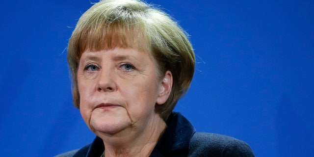 German Chancellor Angela Merkel attends a joint press conference with the Prime Minister of Greece, Andonis Samaras, after a meeting at the chancellery in Berlin, Germany, Friday, Nov. 22, 2013. (AP Photo/Michael Sohn)