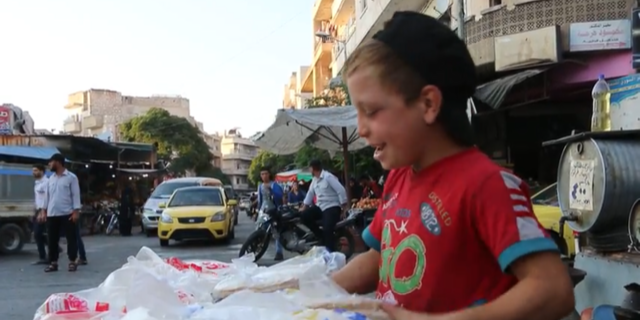 Small children sell food and goods in the Idlib streets