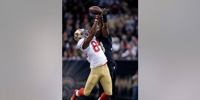 New Orleans Saints cornerback Jabari Greer (33) breaks up a pass intended for San Francisco 49ers wide receiver Jon Baldwin (84) in the first half of an NFL football game in New Orleans, Sunday, Nov. 17, 2013. Greer was hurt on the play. (AP Photo/Dave Martin)