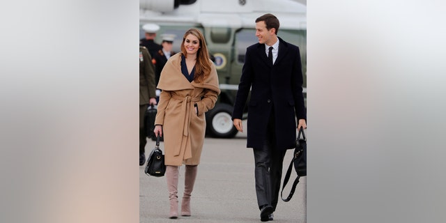 Hicks paired her beige coat and boots with a black bag in Davos, Switzerland.