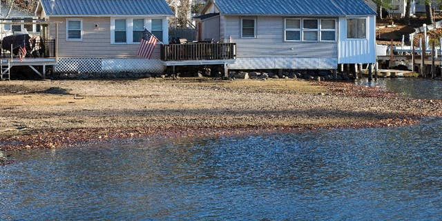 Waterfront cabins are seen on Lake Winnipesaukee Thursday, Nov. 17, 2016, in Laconia, N.H. The long-running drought in much of the Northeastern United States is expected to persist through the winter. The U.S. Drought Monitor map released Thursday shows dry conditions continuing through February throughout New England. (AP Photo/Jim Cole)