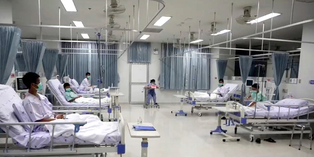 Image made from video shot Friday shows some of the 12 boys rescued from the flooded cave, in their hospital room at Chiang Rai Prachanukroh Hospital in northern Thailand.