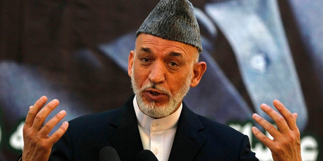 June 18, 2013: Afghan President Hamid Karzai speaks during a joint news conference with NATO Secretary-General Anders Fogh Rasmussen following a security handover ceremony at a military academy outside Kabul.