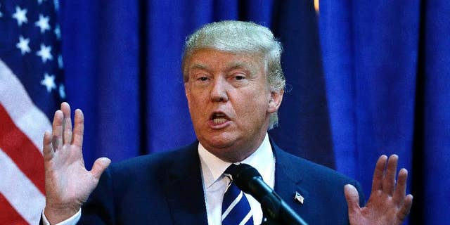 Republican presidential candidate Donald Trump meets the media before addressing a GOP fundraising event, Tuesday, Aug. 11, 2015, in Birch Run, Mich. Trump attended the Lincoln Day Dinner of the Genesee and Saginaw county Republican parties. (AP Photo/Carlos Osorio)