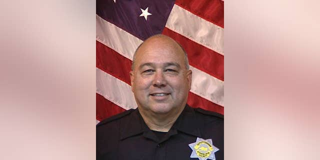 Stanislaus County Sheriff's Department Deputy Dennis Wallace is seen in an undated photo provided by the Stanislaus County, Calif., Sheriff's Department. The department says Deputy Dennis Wallace was shot and killed Sunday, Nov. 13, 2016,  outside the city of Hughson, Calif., while checking on a suspicious car, and that 36-year-old suspect David Machado was arrested in Tulare County. (Stanislaus County Sheriff's Department via AP) .