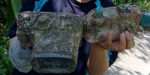 An 11-year-old boy found the camera while cleaning up a beach in Taiwan.