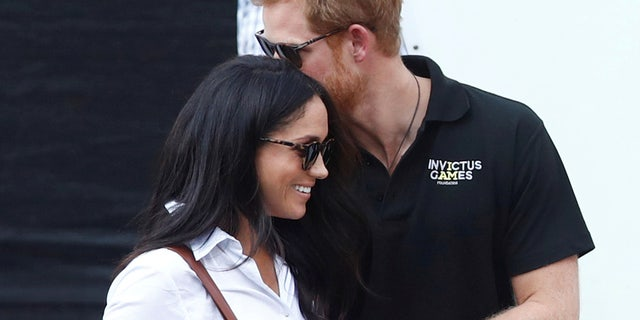 Britain's Prince Harry (R) arrives with girlfriend actress Meghan Markle at the wheelchair tennis event during the Invictus Games in Toronto, Ontario, Canada September 25, 2017.   REUTERS/Mark Blinch     TPX IMAGES OF THE DAY - RC1C2BD3FAF0