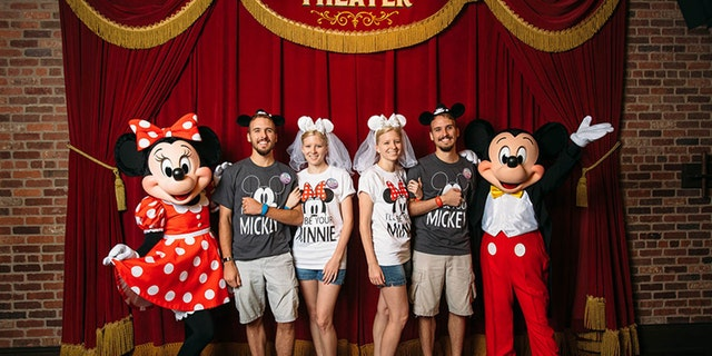 Fittingly, the newlyweds all sported matching Mickey and Minnie Mouse gear for the occasion.