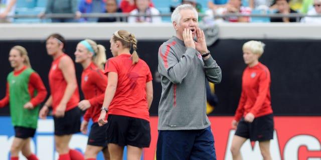 U.S. women's soccer team coach Tom Sermanni yells directions during practice in Jacksonville, Fla., on Friday, Feb. 8, 2013. (AP Photo/The Florida Times-Union, Bob Mack)