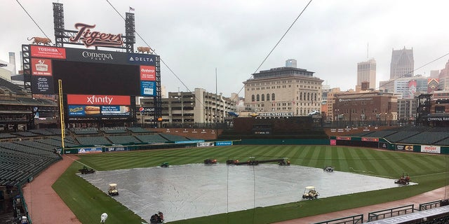 The field is covered as the Yankees and Tigers were rained out at Comerica Park in Detroit, April 14, 2018.