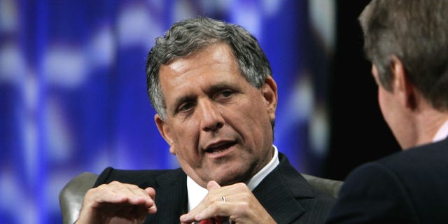 FILE -In this Tuesday, Sept. 12, 2006, file photo, Leslie Moonves, left, president and chief executive officer of CBS, talks with PBS host Charlie Rosein Beverly Hills, Calif. CEO pay has been going up, The highest paid CEO in 2012 was Leslie Moonves of CBS, who made $60.3 million. (AP Photo/Reed Saxon, File)