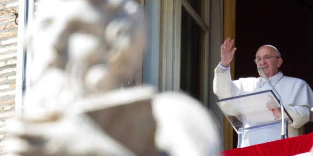 """FILE - In this Sunday, March 8, 2015 file photo, Pope Francis recites the Angelus noon prayer from his studio window overlooking St. Peter's Square at the Vatican. A Vatican official who helped write a first draft of Pope Francis' upcoming encyclical on climate change acknowledged disagreement over the causes of global warming but said """"what is not contested is that our planet is getting warmer"""" and Christians have a duty rooted in """"ancient biblical teaching"""" to address the problem. (AP Photo/Riccardo De Luca)"""